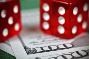 Two Red Dice on Money | Casino Parties NYC | LI