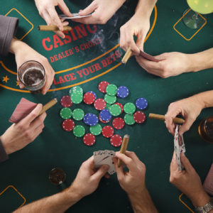 People Playing Poker with Cigars | Long Island Casino Parties