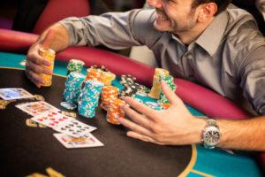 Man Winning Poker | Casino Theme Parties Long Island | NYC