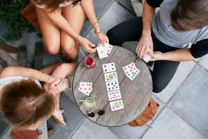 People Playing Poker on Small Table | Casino Party Companies New York City