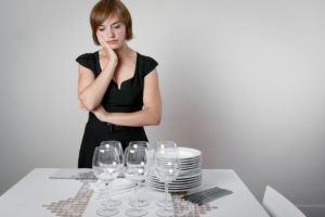 Woman Looking at Dishes | Casino Party Companies LI | New York City
