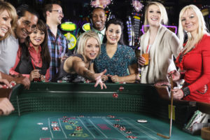 Woman Throwing Dice with Friends | Casino Party Companies LI