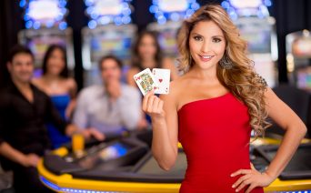 Woman Holding Playing Cards | Casino Party Companies NYC | LI